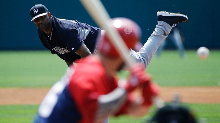 New York Yankees starting pitcher CC Sabathia throws to Washington Nationals' Jeff Kobernus in the first inning of an exhibition spring training baseball game, Tuesday, March 11, 2014, in Viera, Fla. (AP Photo/David Goldman)