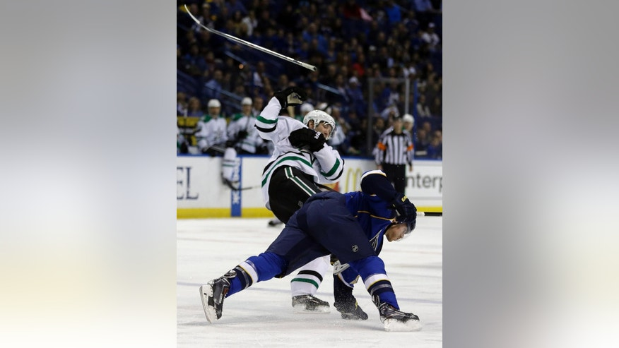 Dallas Stars' Erik Cole, left, loses his stick after colliding with St. Louis Blues' Ian Cole during the first period of an NHL hockey game Tuesday, March 11, 2014, in St. Louis. (AP Photo/Jeff Roberson)