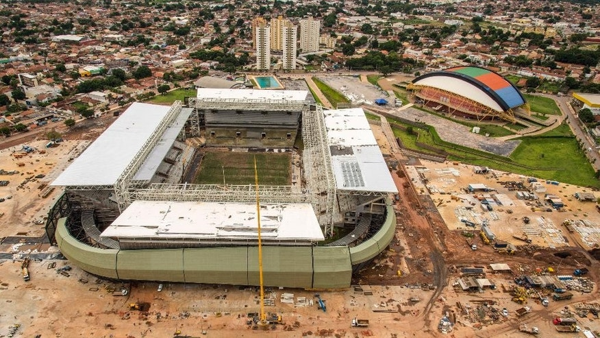 ADVANCE FOR SUNDAY, MARCH 16  AND THEREAFTER - This Jan. 10, 2014 photo released by Portal da Copa shows an aerial view of the Arena Pantanal in Cuiaba, Brazil. Brazil isn't alone among nations whose preparations for the Cup came under fire. South Africa, the last host, had serious security problems and delivered many works related to the tournament at the last moment. But Brazil is in worse shape, with FIFA President Sepp Blatter saying earlier this year that the country was further behind than any host he had dealt with during his four decades at the world governing body, despite having more time to prepare. (AP Photo/Portal da Copa, Jose Medeiros)