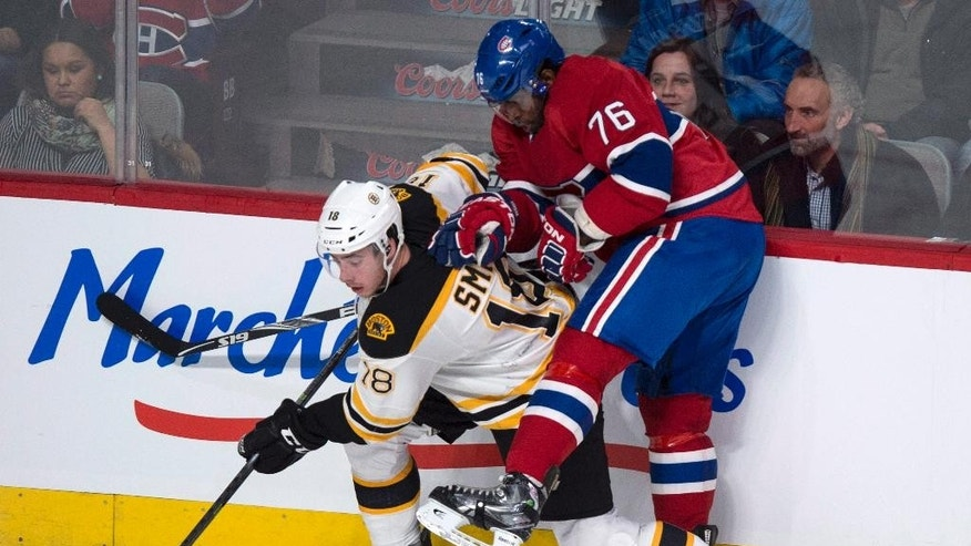 Montreal Canadiens' P.K. Subban tries to stop Boston Bruins' Reilly Smith during first period NHL hockey action Wednesday, March 12, 2014 in Montreal. (AP Photo/The Canadian Press, Paul Chiasson)