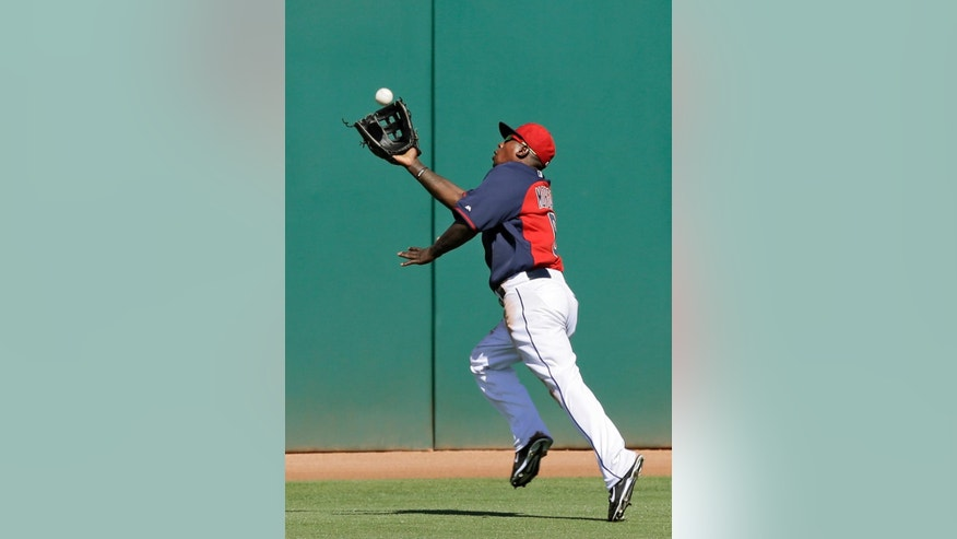 Cleveland Indians center fielder Nyjer Morgan makes a running catch on a deep fly ball hit by San Diego Padres' Tommy Medica in the fifth inning of a spring exhibition baseball game on Wednesday, March 12, 2014, in Goodyear, Ariz. (AP Photo/Mark Duncan)