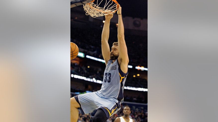 Memphis Grizzlies center Marc Gasol (33) dunks against the New Orleans Pelicans in the first half of an NBA basketball game in New Orleans, Wednesday, March 12, 2014. (AP Photo/Scott Threlkeld)