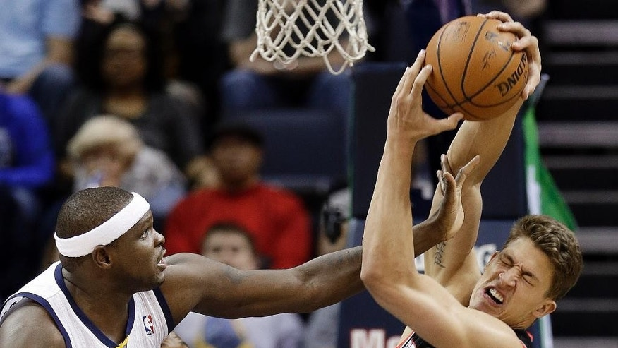 Portland Trail Blazers center Meyers Leonard (11) gets a hand in the face from Memphis Grizzlies forward Zach Randolph (50) in the first half of an NBA basketball game on Tuesday, March 11, 2014, in Memphis, Tenn. (AP Photo/Mark Humphrey)