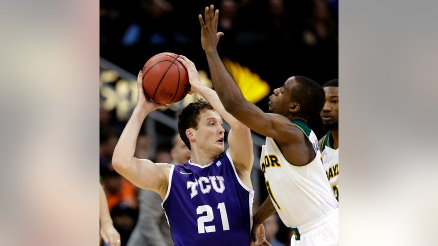 TCU's Hudson Price (21) tries to pass around Baylor's Kenny Chery during the first half of an NCAA college basketball game in the Big 12 men's tournament on Wednesday, March 12, 2014, in Kansas City, Mo. (AP Photo/Charlie Riedel)