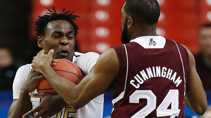 Vanderbilt forward James Siakam (35) runs into Mississippi State guard Tyson Cunningham (24) during the first half in a first round Southeastern Conference tournament game, Wednesday, March 12, 2014, in Atlanta. (AP Photo/John Bazemore)
