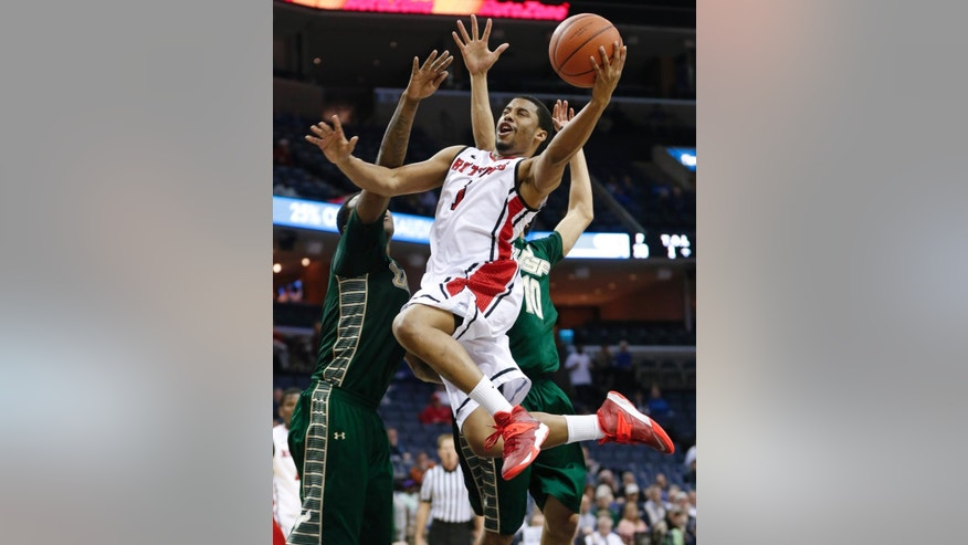 Rutgers guard Jerome Seagears, front, drives past South Florida defenders Victor Rudd, left, and Josh Heath (10) during the second half of an NCAA college basketball game at the American Athletic Conference men's tournament Wednesday, March 12, 2014, in Memphis, Tenn. Rutgers won 72-68. (AP Photo/Mark Humphrey)