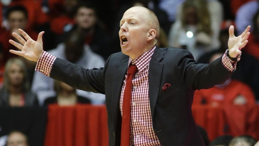 Cincinnati head coach Mick Cronin yells at his players in the second half of an NCAA college basketball game against Memphis, Thursday, March 6, 2014, in Cincinnati. Cincinnati won 97-84. (AP Photo/Al Behrman)