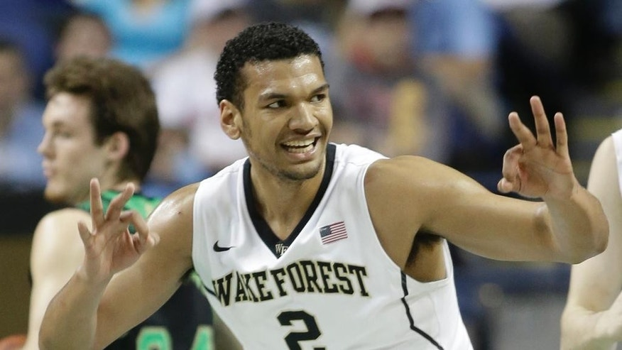 Wake Forest's Devin Thomas (2) reacts after making a basket against Notre Dame during the first half of a first round NCAA college basketball game at the Atlantic Coast Conference tournament in Greensboro, N.C., Wednesday, March 12, 2014. (AP Photo/Bob Leverone)