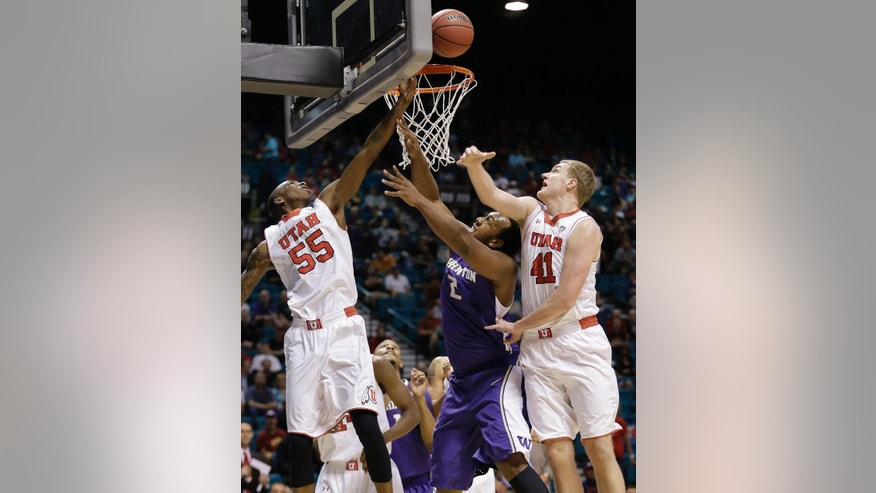 Washington's Perris Blackwell (2) puts up a shot against Utah's Delon Wright (55) and Jeremy Olsen (41) in the first half of an NCAA Pac 12 conference tournament college basketball game, Wednesday, March 12, 2014, in Las Vegas. (AP Photo/Julie Jacobson)