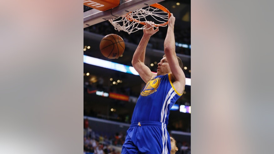Golden State Warriors David Lee dunks against the Los Angeles Clippers during the first half of an NBA basketball game in Los Angeles, Wednesday, March 12, 2014. (AP Photo/Danny Moloshok)