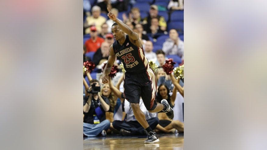 Florida State's Aaron Thomas (25) reacts after making a basket against Maryland during the second half of an NCAA college basketball game in the second round of the Atlantic Coast Conference tournament in Greensboro, N.C., Thursday, March 13, 2014. (AP Photo/Gerry Broome)