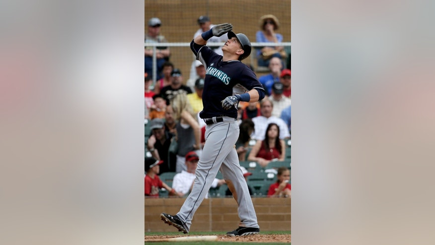 Seattle Mariners' Logan Morrison celebrates a solo home run against the Arizona Diamondbacks during the fifth inning of a spring exhibition baseball game in Scottsdale, Ariz., Thursday, March 13, 2014. (AP Photo/Chris Carlson)