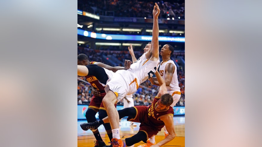 Phoenix Suns center Miles Plumlee (22) is fouled by Cleveland Cavaliers center Spencer Hawes (32) during the first half of their NBA basketball game, Wednesday, March 12, 2014, in Phoenix, Ariz. (AP Photo/The Arizona Republic, David Kadlubowski) MARICOPA COUNTY OUT; MAGS OUT; NO SALES.
