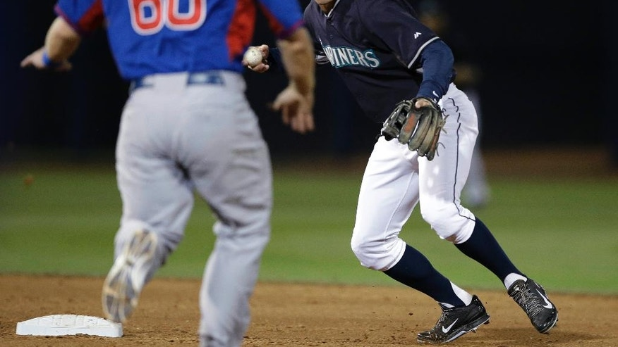 Chicago Cubs' Chris Valaika is forced at second as Seattle Mariners' Brad Miller throws to complete a double play during the second inning of a spring exhibition baseball game Wednesday, March 12, 2014, in Peoria, Ariz. (AP Photo/Darron Cummings)