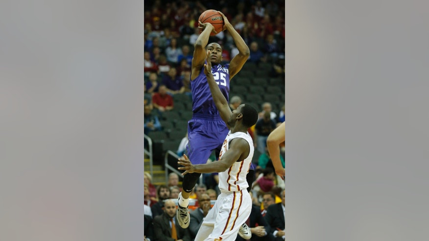 Kansas State guard Wesley Iwundu (25) shoots over Iowa State forward Dustin Hogue (22) during the first half during the first half of an NCAA college basketball game in the quarterfinals of the Big 12 Conference men's tournament in Kansas City, Mo., Thursday, March 13, 2014. (AP Photo/Orlin Wagner)