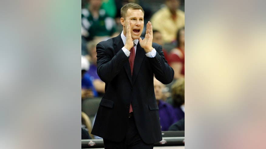 Iowa State head coach Fred Hoiberg yells to his team during the first half of an NCAA college basketball game agaisnt Kansas State in the quarterfinals of the Big 12 Conference men's tournament  in Kansas City, Mo., Thursday, March 13, 2014. (AP Photo/Orlin Wagner)