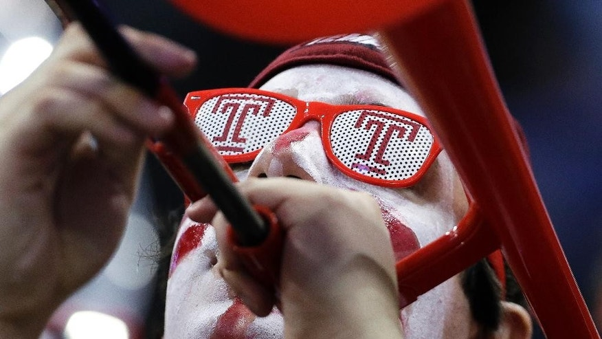 A member of the Temple band plays in the first half of an NCAA college basketball game between Temple and Central Florida at the American Athletic Conference men's tournament Wednesday, March 12, 2014, in Memphis, Tenn. (AP Photo/Mark Humphrey)