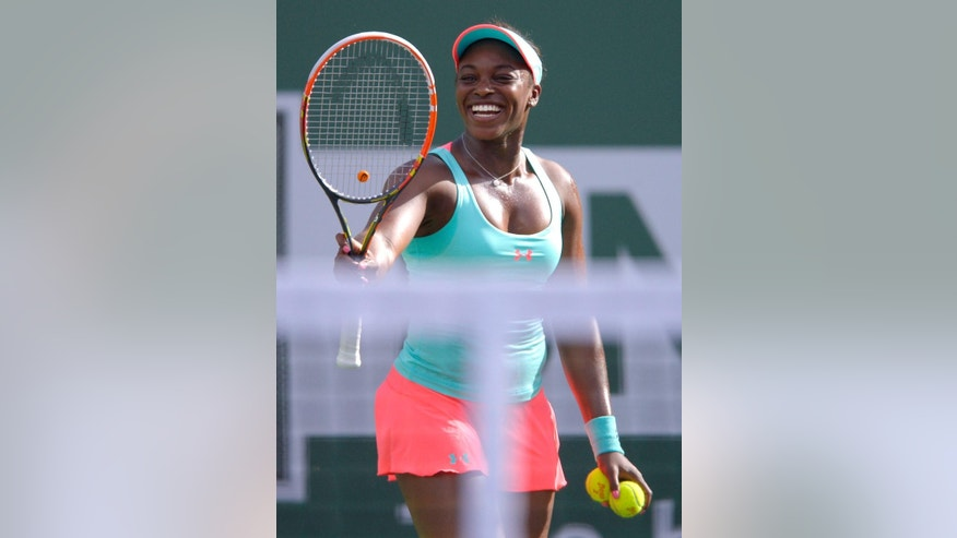 Sloane Stephens smiles prior to serving to Flavia Pennetta, of Italy, during a quarterfinal match at the BNP Paribas Open tennis tournament, Thursday, March 13, 2014, in Indian Wells, Calif. (AP Photo/Mark J. Terrill)