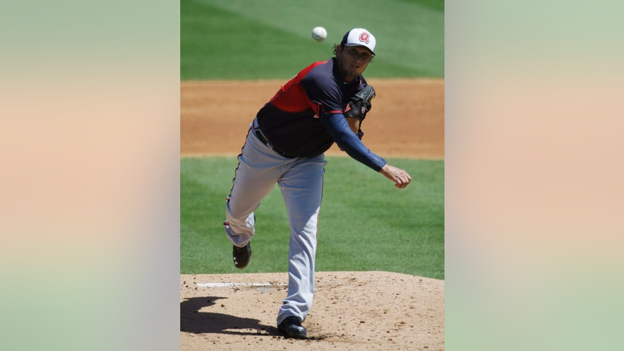 Atlanta Braves starting pitcher Freddy Garcia throws in the first inning of an exhibition spring training baseball game against the St. Louis Cardinals, Thursday, March 13, 2014, in Jupiter, Fla. (AP Photo/David Goldman)