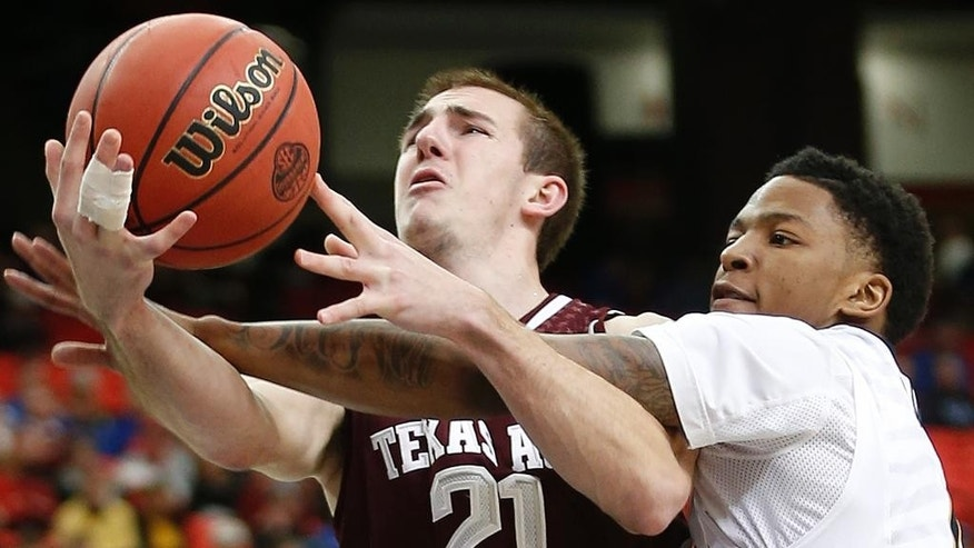 Texas A&M guard Alex Caruso (21) is fouled by Missouri guard Wes Clark (1) during the second half of an NCAA college basketball game in the second round of the Southeastern Conference men's tournament, Thursday, March 13, 2014, in Atlanta. (AP Photo/John Bazemore)