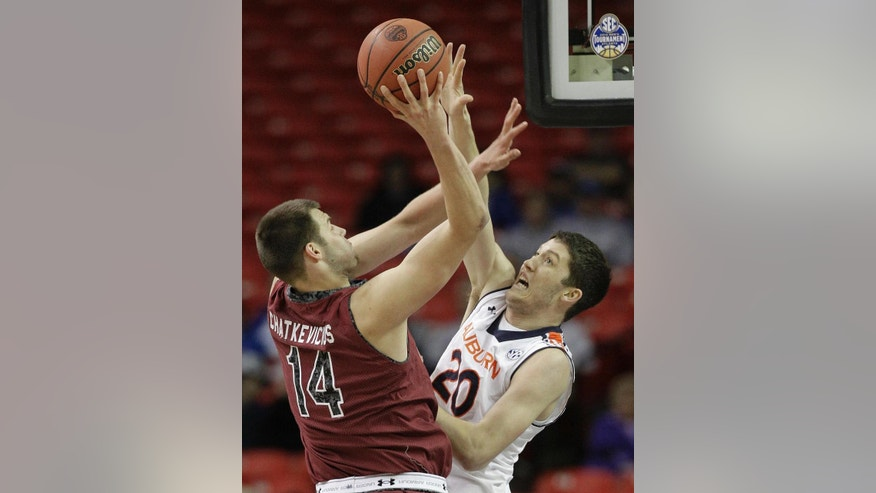 South Carolina forward Laimonas Chatkevicius (14) shoots against Auburn forward Alex Thompson (20) during the second half in a first round Southeastern Conference tournament game, Wednesday, March 12, 2014, in Atlanta. (AP Photo/Steve Helber)