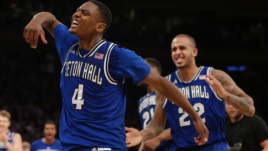 Seton Hall's Sterling Gibbs, left, celebrates after sinking the game-winning basket late in the second half of an NCAA college basketball game against Villanova in the second round of the Big East Conference tournament at Madison Square Garden, Thursday, March 13, 2014 in New York. Seton Hall defeated Villanova 64-63.(AP Photo/Seth Wenig)