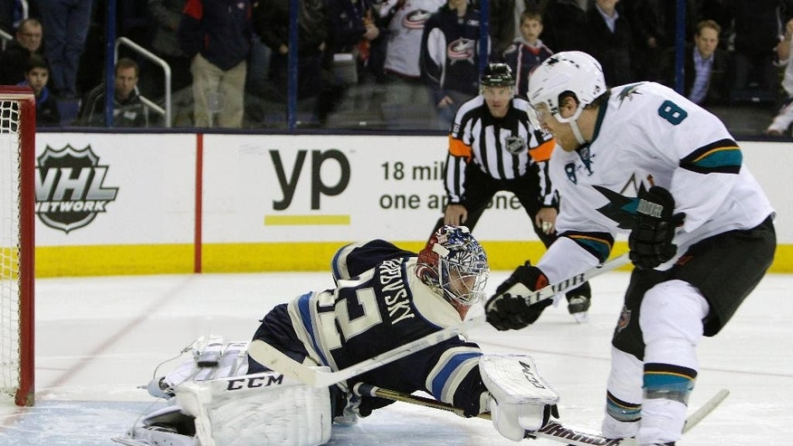 San Jose Sharks' Joe Pavelski, right, scores a goal against Columbus Blue Jackets' Sergei Bobrovsky, of Russia, during the shootout of an NHL hockey game, Thursday, March 13, 2014, in Columbus, Ohio. The Sharks defeated the Blue Jackets 4-3 in a shootout. (AP Photo/Jay LaPrete)