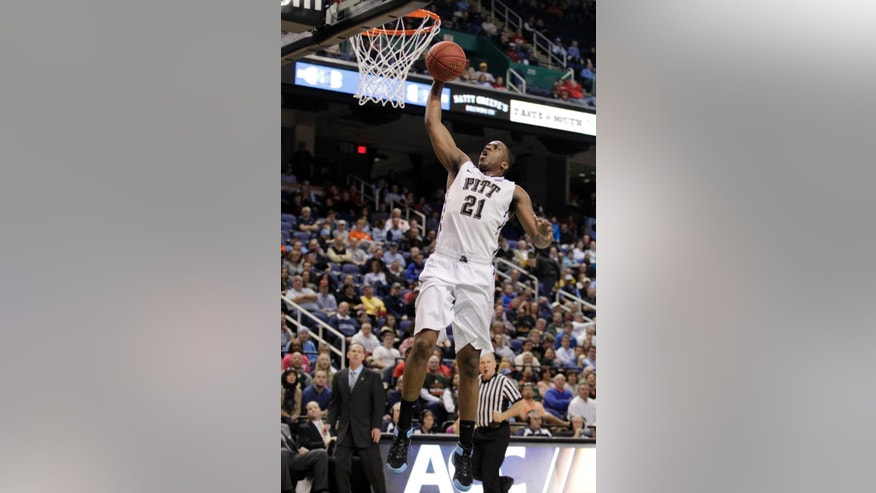 Pittsburgh's Lamar Patterson goes up to dunk against Wake Forest during the second half of a second round NCAA college basketball game at the Atlantic Coast Conference tournament in Greensboro, N.C., Thursday, March 13, 2014. (AP Photo/Bob Leverone)