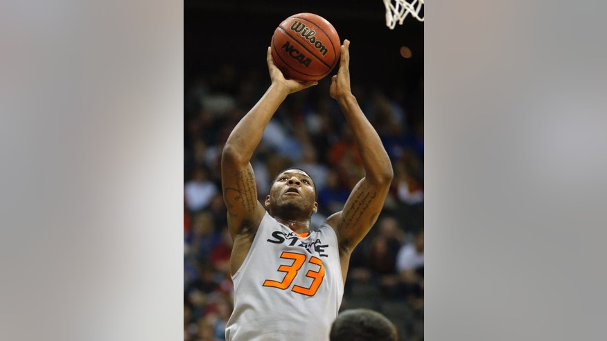 Oklahoma State guard Marcus Smart (33) shoots a basket during the second half of an NCAA college basketball game against Texas Tech in the Big 12 men's tournament in Kansas City, Mo., Wednesday, March 12, 2014. Oklahoma State defeated Texas Tech 80-62. (AP Photo/Orlin Wagner)