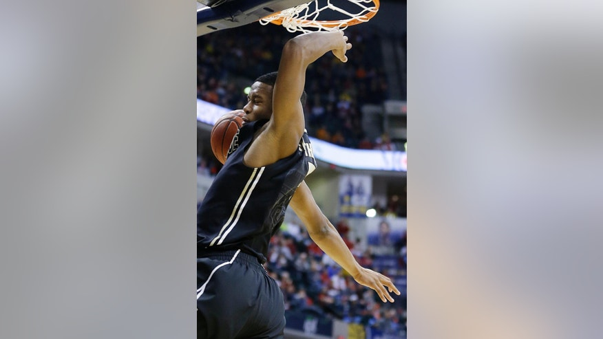 Purdue forward Basil Smotherman dunks in the first half of an NCAA college basketball game against Ohio State in the first round of the Big Ten Conference tournament Thursday, March 13, 2014, in Indianapolis. (AP Photo/Michael Conroy)