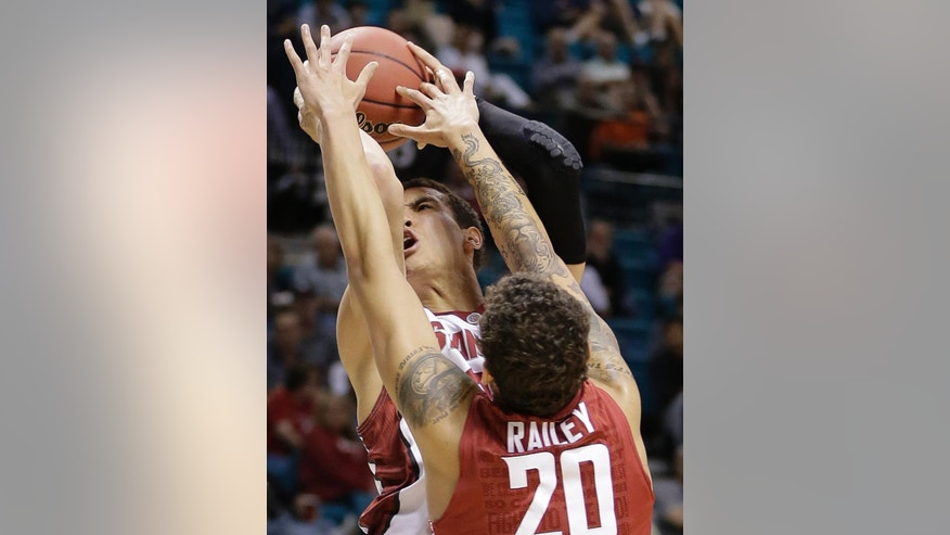 Stanford's Dwight Powell is fouled as he shoots against Washington State's Jordan Railey in the first half of an NCAA college basketball game in the Pac-12 men's tournament, Wednesday, March 12, 2014, in Las Vegas. (AP Photo/Julie Jacobson)
