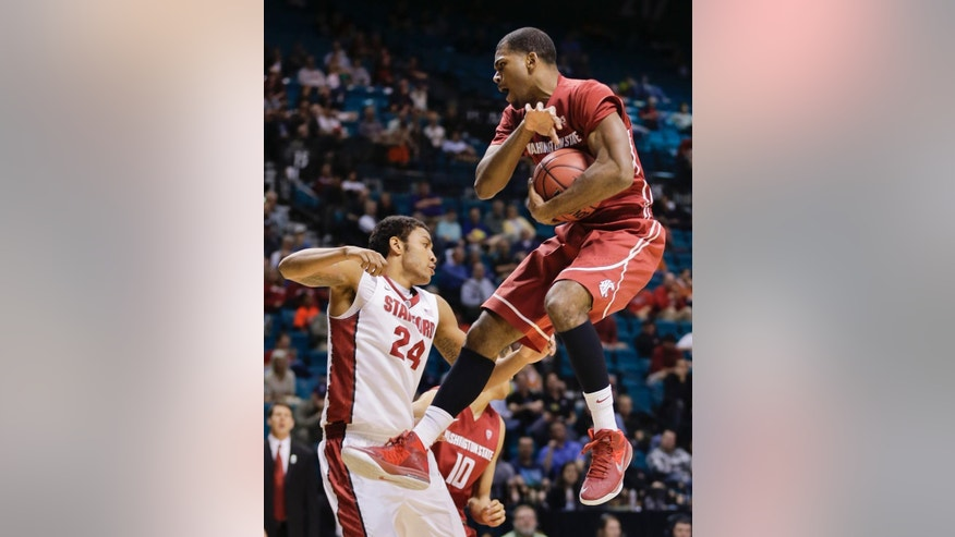 Washington State's Royce Woolridge, right, grabs a rebound against Stanford's Josh Huestis in the first half of an NCAA college basketball game in the Pac-12 men's tournament, Wednesday, March 12, 2014, in Las Vegas. (AP Photo/Julie Jacobson)