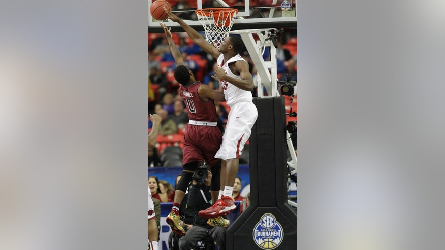 South Carolina's Sindarius Thornwell shoots against Arkansas center Moses Kingsley (33) during the first half of an NCAA college basketball game in the second round of the Southeastern Conference men's tournament, Thursday, March 13, 2014, in Atlanta. (AP Photo/Steve Helber)