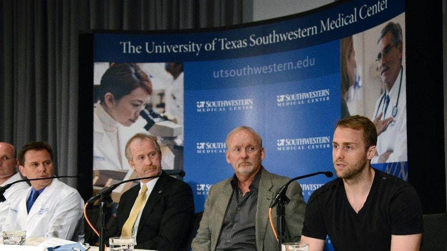 Dallas Stars forward Rich Peverley, right, makes a statement regarding his health and the incident which occurred in a recent NHL game during a news conference at UT Southwestern Medical Center Wednesday, March 12, 2014, in Dallas. Stars coach Lindy Ruff, general manager Bill Nill and team medical services director Dr. Robert J. Dimeff, M.D., left, look on. (AP Photo/Tim Sharp)