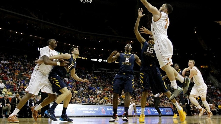 Texas' Javan Felix (3) shoots during the first half of an NCAA college basketball game against West Virginia in the Big 12 men's tournament on Thursday, March 13, 2014, in Kansas City, Mo. (AP Photo/Charlie Riedel)