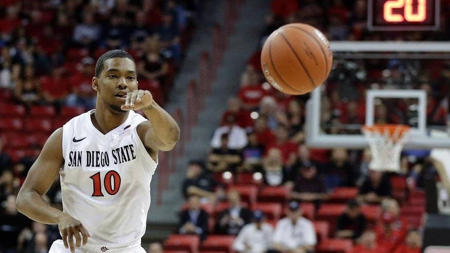 San Diego State's Aqeel Quinn passes to a teammate during the first half an NCAA college basketball game against Utah State in the quarterfinals of the Mountain West Conference tournament Thursday, March 13, 2014, in Las Vegas. (AP Photo/Isaac Brekken)