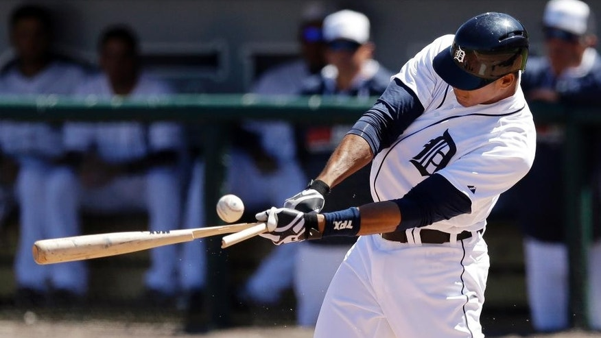 Detroit Tigers' Steven Moya breaks his bat during the fourth inning of a spring exhibition baseball game against the Miami Marlins in Lakeland, Fla., Thursday, March 13, 2014. (AP Photo/Carlos Osorio)