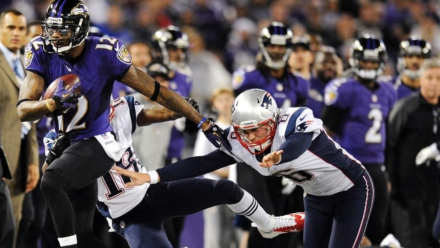 FILE - In this Dec. 22, 2013 file photo, Baltimore Ravens wide receiver Jacoby Jones, from left, rushes a punt return out of bounds past New England Patriots' Matthew Slater and Ryan Allen during an NFL football game in Baltimore. The Ravens and Jones agreed on a four-year contract Wednesday, March 12, 2014, after he drew interest from other teams as a free agent.(AP Photo/Nick Wass, File)