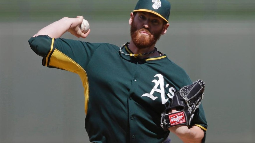 Oakland Athletics starting pitcher Dan Straily throws during the second inning of a spring exhibition baseball game against the Kansas City Royals on Friday, March 14, 2014, in Surprise, Ariz. (AP Photo/Darron Cummings)