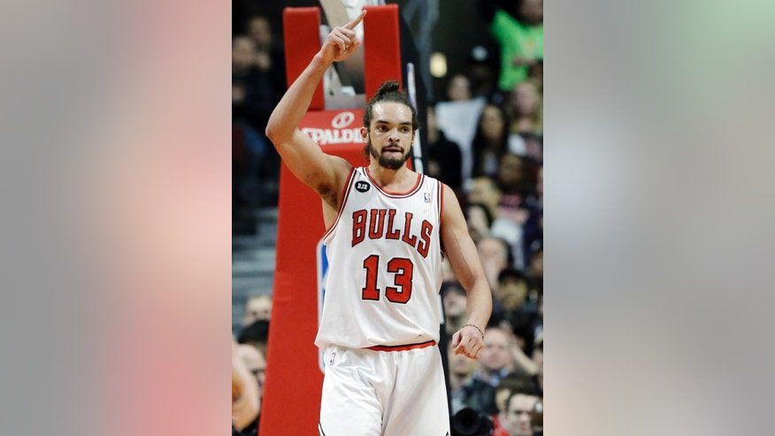 Chicago Bulls center Joakim Noah celebrates after scoring a basket during the first half of an NBA basketball game against the Houston Rockets in Chicago on Thursday, March 13, 2014. (AP Photo/Nam Y. Huh)