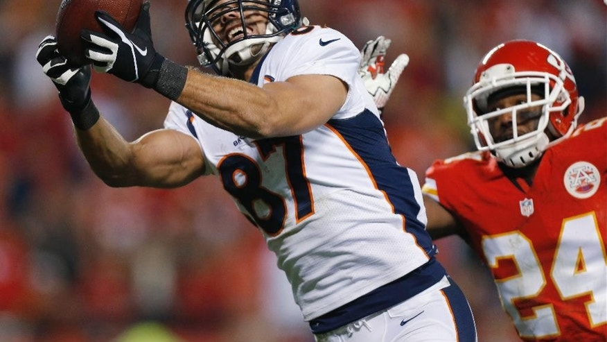 FILE - In this Dec. 1, 2013 file photo, Denver Broncos wide receiver Eric Decker (87) makes a touchdown reception against Kansas City Chiefs cornerback Brandon Flowers during an NFL football game in Kansas City, Mo. The New York Jets have agreed to terms with Decker, considered by many the top free agent at his position. (AP Photo/Ed Zurga, File)