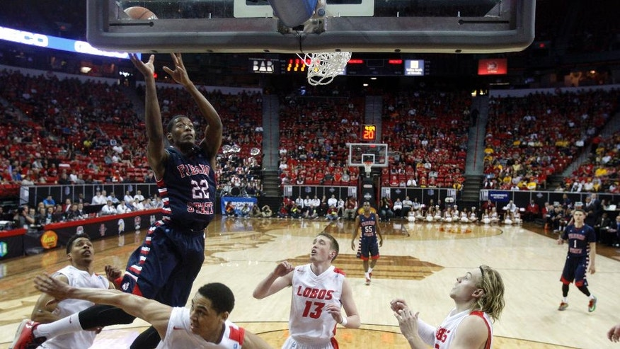 Fresno State's Paul Watson (22) shoots over the New Mexico defense during the first half of an NCAA college basketball game in the quarterfinals of the Mountain West Conference tournament, Thursday, March 13, 2014, in Las Vegas. (AP Photo/Isaac Brekken)