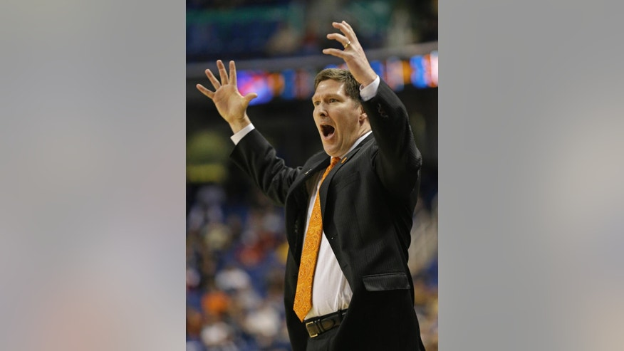 Clemson head coach Brad Brownell reacts to a call during the first half of a second round NCAA college basketball game after the game at the Atlantic Coast Conference tournament in Greensboro, N.C., Thursday, March 13, 2014. (AP Photo/Gerry Broome)