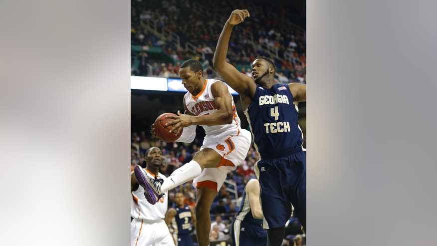 Clemson's Jaron Blossomgame (5) grabs a rebound in  front of Georgia Tech's Robert Carter, Jr. (4) during the first half of a second round NCAA college basketball game at the Atlantic Coast Conference tournament in Greensboro, N.C., Thursday, March 13, 2014. (AP Photo/Gerry Broome)