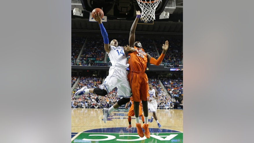 Duke's Rasheed Sulaimon (14) shoots as Clemson's Landry Nnoko (35) defends during the first half of a quarterfinal NCAA college basketball game at the Atlantic Coast Conference tournament in Greensboro, N.C., Friday, March 14, 2014. (AP Photo/Gerry Broome)