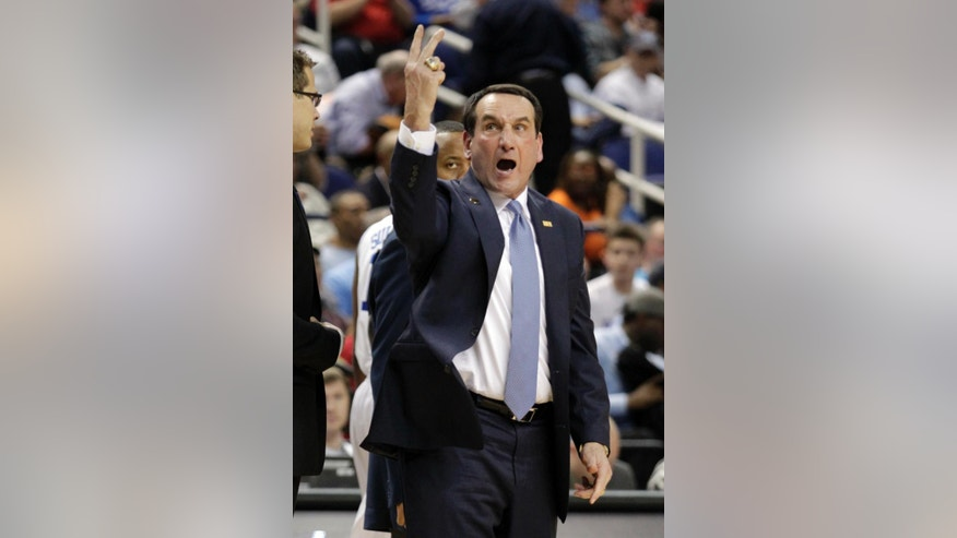 Duke head coach Mike Krzyzewski reacts to a call at the end of the first half of a quarterfinal NCAA college basketball game against Clemson at the Atlantic Coast Conference tournament in Greensboro, N.C., Friday, March 14, 2014. (AP Photo/Bob Leverone)