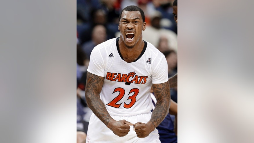 Cincinnati guard Sean Kilpatrick celebrates after scoring against Connecticut during the first half of an NCAA college basketball game in the semifinals of the American Athletic Conference tournament Friday, March 14, 2014, in Memphis, Tenn. (AP Photo/Mark Humphrey)
