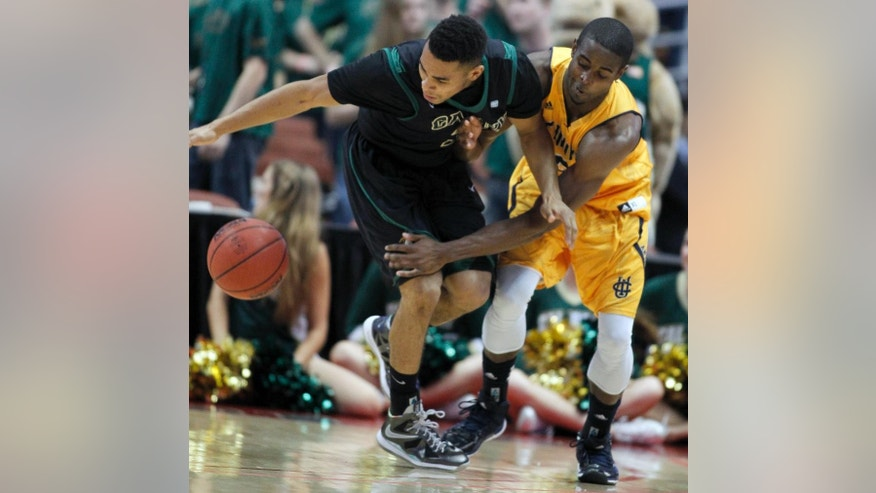 Cal Poly guard Kyle Odister, left, steals the ball away from UC Irvine guard Chris McNealy during in the first half of an NCAA college basketball game of the Big West Conference men's tournament in Anaheim, Calif., Friday, March 14, 2014. (AP Photo/Alex Gallardo)