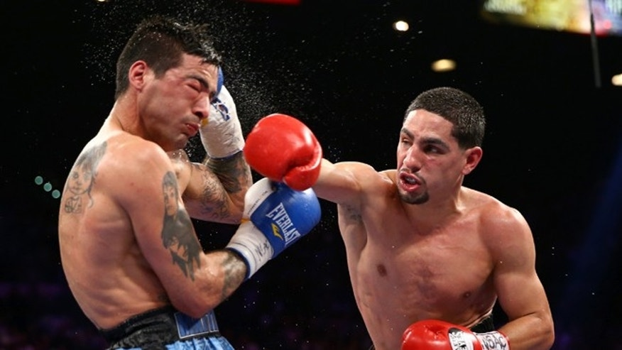 LAS VEGAS, NV - SEPTEMBER 14:  (R-L) Danny Garcia throws a right to the head of Lucas Matthysse during their WBC/WBA super lightweight title fight at the MGM Grand Garden Arena on September 14, 2013 in Las Vegas, Nevada.  (Photo by Al Bello/Getty Images)