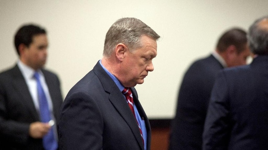 FILE - In this Feb. 21, 2013, file photo,  Former Fiesta Bowl CEO John Junker appears in Maricopa County Superior Court in Phoenix, Ariz. Junker, who acknowledged participating in an illegal campaign contribution scheme, faces sentencing Thursday, March 13, 2014, in federal court. Junker pleaded guilty two years ago to a federal conspiracy charge after being accused of being involved in the scheme in which Fiesta Bowl employees made illegal campaign contributions to politicians and were reimbursed by the nonprofit bowl.  (AP Photo/The Arizona Republic, Mark Henle, File)  MARICOPA COUNTY OUT; MAGS OUT; NO SALES.
